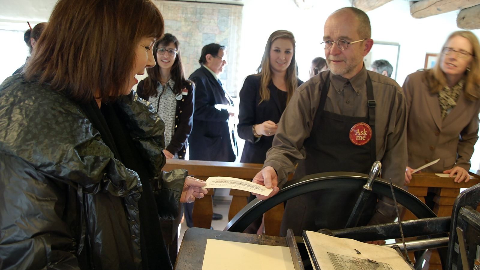 Curator Tom Leech assists in the printing of a souvenir impression of the Palace. Photo by Hannah Abelbeck