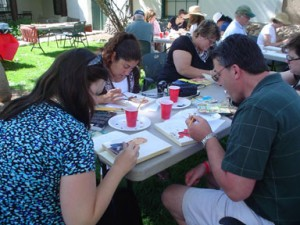A group of teachers in the NEH-UNM workshop enjoy painting retablos on a cool Santa Fe morning.