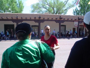 Garcia talks about the design of the Palace of the Governors during a walk around the Santa Fe Plaza.