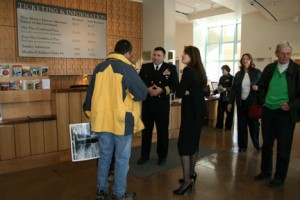 Cmdr. George Perez greeting visitors in the New Mexico History Museum lobby.