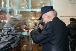 Ret. CWO George Smith pointing to the place on the BB 40 model where he was stationed during WW2.