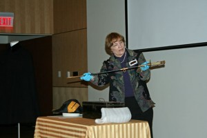 Collections Manager Wanda Edwards with a pre-WW2, sharkskin-handled sword.