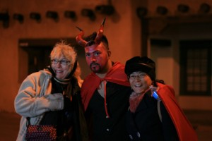 ...and some folks can't resist posing with a handsome devil.