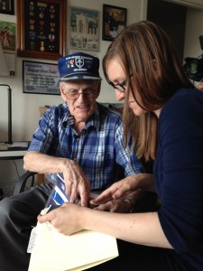 Curator Meredith Davidson interviews World War II veteran Elvert Pooler.